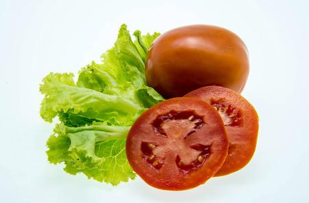 Fresh tomato and green salad on white background photo
