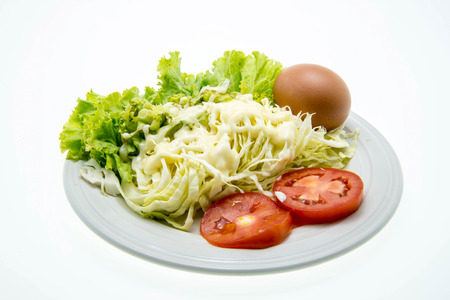 fresh salad in a white plate photo