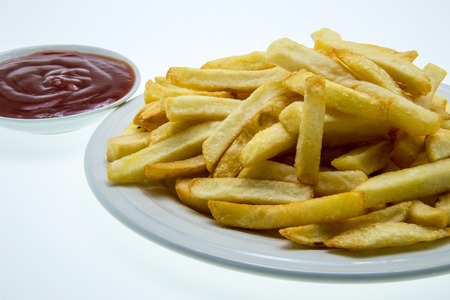 quick snack: French fries with ketchup on white background Stock Photo