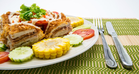 Cordon with vegetables garnish photo