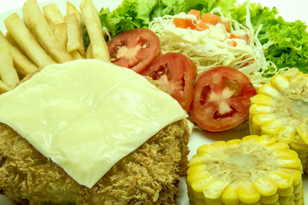 Pork chop Cordon, with French fries and vegetables garnish  photo
