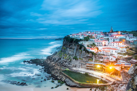 magic hour: Azenhas do Mar village at dusk with stormy sea and dark clouds, Sintra Portugal Stock Photo