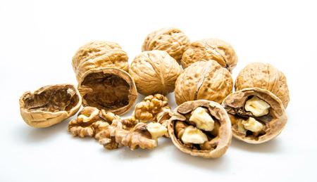 walnut and a cracked walnut isolated on the white background photo