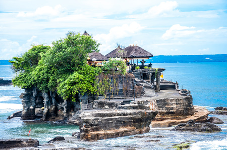 Tanah Lot means Land Sea in Balinese language Located in Tabanan, about 20 km from Denpasar, the temple is on offshore rock which has been shaped continuously over the years by the ocean tide.