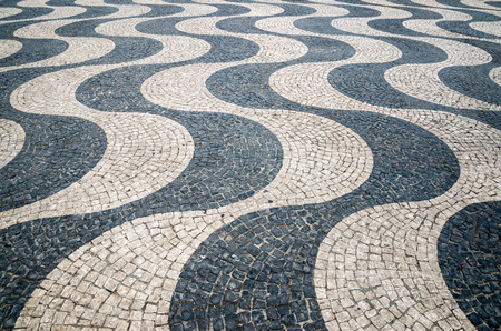 Typical portuguese cobblestone hand-made pavement in Portugal, Lisbon. Banco de Imagens