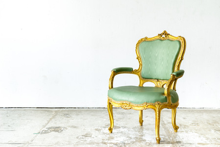 Luxurious classical vintage armchair on white background photo