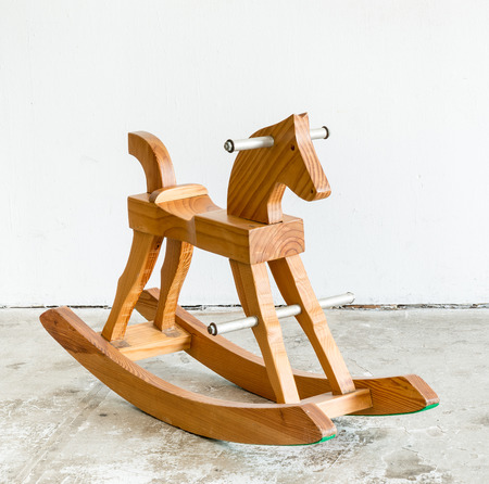 rocking horse: Cute vintage classic rocking horse chair children could enjoy the riding on white background Stock Photo