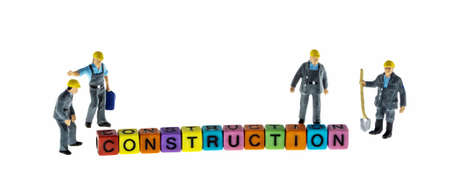 miniature: construction man miniature figure with construction word