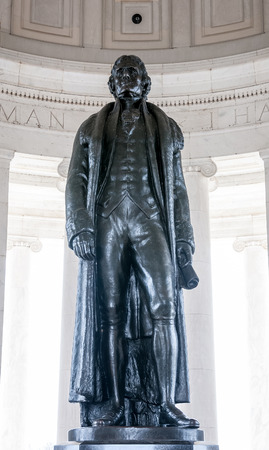 declaration of independence: Bronze statue of Thomas Jefferson in front of engraved wall with text of the American Declaration of Independence at the president memorial in Washington DC Stock Photo