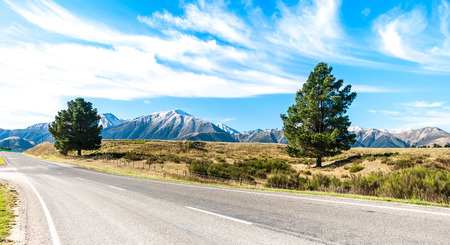 asphalt: asphalt highway curve road to mountain cook New Zealand with cloud and sky