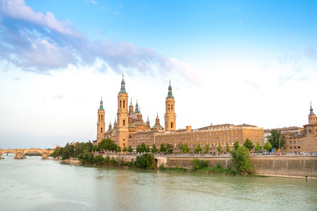 catholic church: Basilica - Cathedral of Our Lady of Pillar and Ebro River in Zaragoza, Aragon, Spain. Pilar cathedral is Roman Catholic Church.