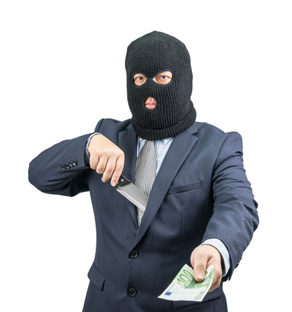 swindled: Criminal holding money with knife from suit on white background