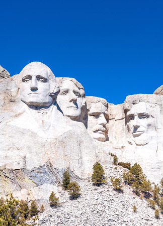 theodore roosevelt: Mount Rushmore National Monument in South Dakota. Vertical image on a clear day.