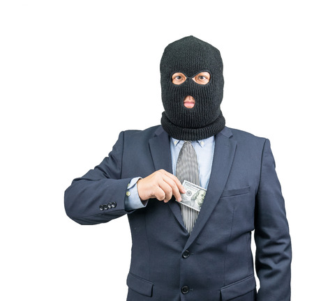 con man: Criminal holding money from suit on white background Stock Photo