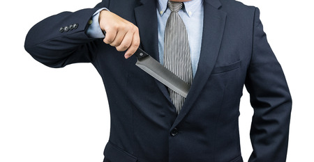 paranoid: Man pulling knife out form suit on white background