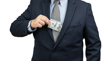 pulling money: Man pulling dollar money cash out form suit on white background Stock Photo