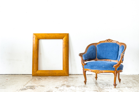 antique background: Luxurious classical vintage armchair with empty classic frame on white background