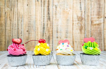 Colorful Cupcake on wood vintage background