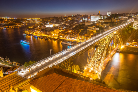 lighted: Panorama of lighted famous bridge Ponte dom Luis above Old town Porto and river Duoro at night, Portugal