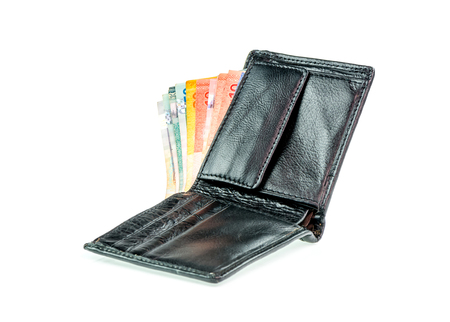 batch of euro: Malaysia ringkit in leather wallet on white background