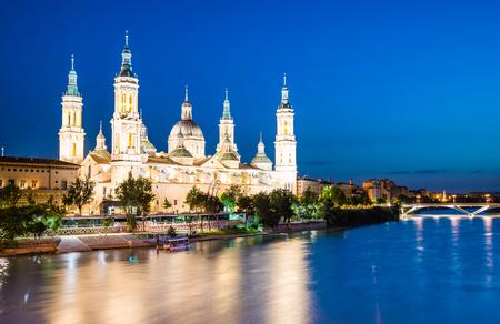 Our Lady of the Pillar Basilica with Ebro River at dusk Zaragoza, Spain Stok Fotoğraf