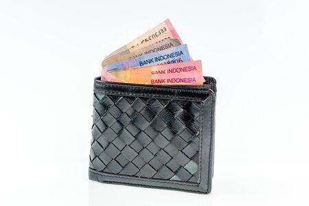 batch of euro: Indonesia Rupiah in leather wallet on white background Stock Photo