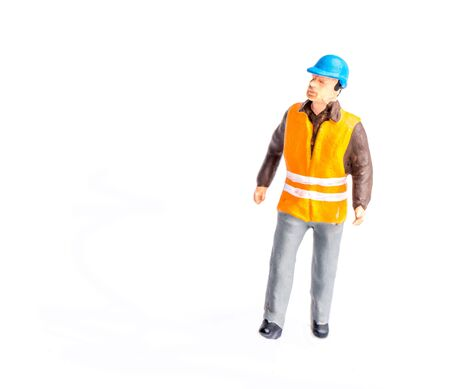 Miniature people engineer worker man on white background