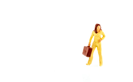Miniature people business traveler concept on white background with a space for text