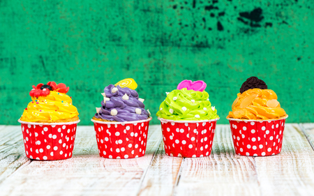 cup cakes: Colorful Cupcake on wood vintage background