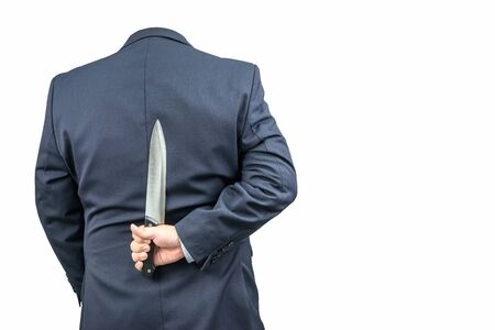 holding a knife: Invisible man in a suit holding a knife on a white background. Stock Photo