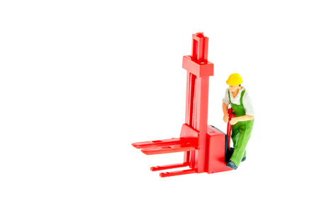Miniature people engineer worker in factory concept on white background with a space for text