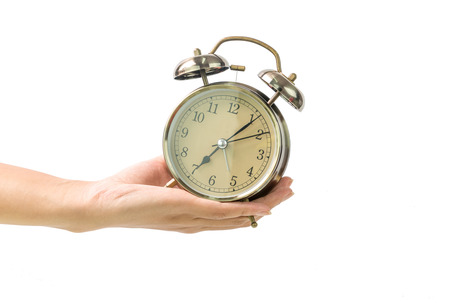Hand holding Alarm Clock on white background