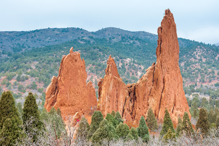 scrambling: Beautiful red rock formations at Garden of the Gods is a public park located in Colorado Springs, Colorado, US. It was designated a National Natural Landmark