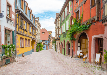 riesling: Alley in medieval Riquewihr town on wine route Alsace. Riquewihr known for the Riesling and other great wines produced in the village. Stock Photo