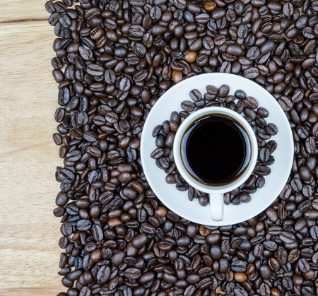 cofee: Cup of cofee with coffee beans on a wood table
