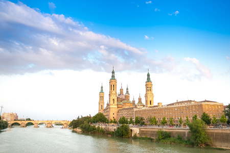 roman pillar: Basilica - Cathedral of Our Lady of Pillar and Ebro River in Zaragoza, Aragon, Spain. Pilar cathedral is Roman Catholic Church.