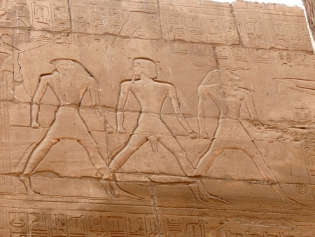 Wall with ancient egyptian symbols in luxor photo