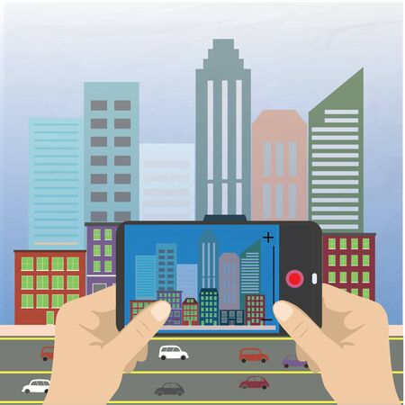 Hand holding a smartphone and makes photo cityscape, flat design Vector