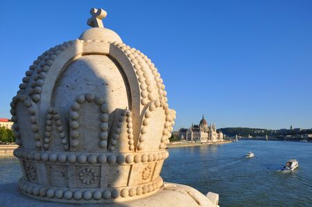 The crown on the bridge over the Danube and the Parliament Building, Budapest, Hungary
