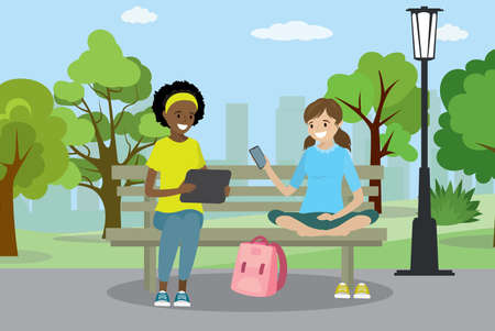 Two teen girls with gadgets are sitting on the bench in Public park, trees and buildings  on background, flat vector illustration.