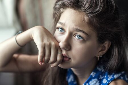 annoyance: portrait of teen girl that is depressed Stock Photo