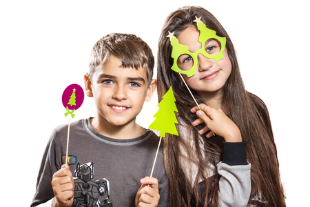 Happy boy and girl, try on funny masks Archivio Fotografico
