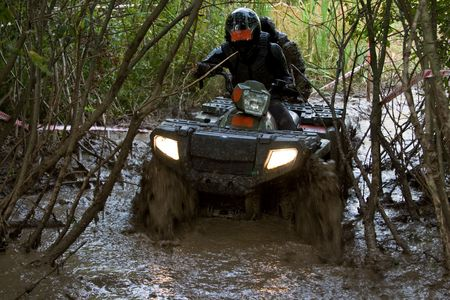 Sportsman riding quad bike at extreme competition photo
