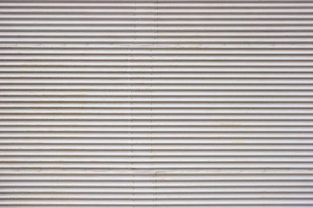 Weathered painted corrugated metal sheet texture background photo