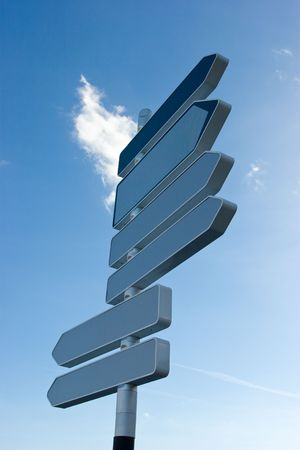 Signpost against blue sky with blank direction arrows Stock Photo - 2744728