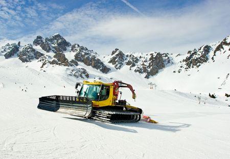 snowcat: A snowcat grooming the ski slopes at French Alps