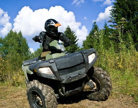 quad: Sportsman riding quad bike at the summer forest Stock Photo