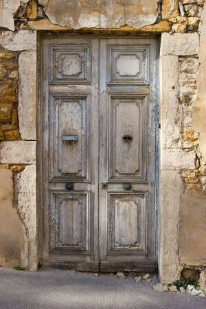 Old weathered wooden door with sunbeam on it Stock Photo - 2913717