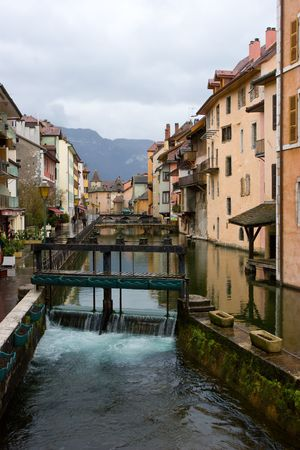 sluice: Canal with sluice gate at medieval town of Annecy, France Stock Photo