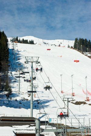 Chairlift beside a piste Meribel ski resort, French Alps photo